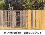 Close Up New Wooden Fence Near...