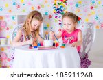 two happy girls draw  paints at ... | Shutterstock . vector #185911268