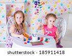 girls draw on the album | Shutterstock . vector #185911418