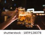 asian friends drinking beer...   Shutterstock . vector #1859128378