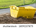 A Yellow Skip  Container Is...