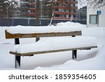 A Wooden Bench Under The Snow...