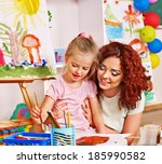 child with mother painting .... | Shutterstock . vector #185990582