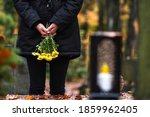 Mourning Woman Holding Flowers...