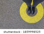 Black shoes standing in yellow...
