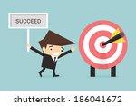 businessman showing target | Shutterstock .eps vector #186041672