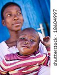 african boy and mother sitting... | Shutterstock . vector #18604997