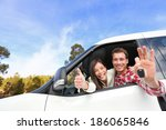 new car   happy couple showing... | Shutterstock . vector #186065846