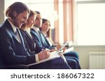 row of business people making...   Shutterstock . vector #186067322