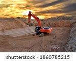 Excavator Digging The Pit...
