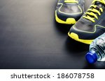 sport shoes and water on grey... | Shutterstock . vector #186078758