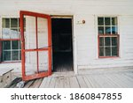 Old Wooden Red Door Propped...