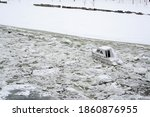 White Boat Trapped In Ice In...