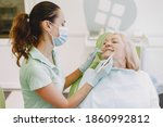 Small photo of Senior woman having dental treatment at dentist's office. Woman is being treated for teeth