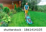 Lawn Care. Mowing Grass With An ...