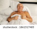 Old Man Sleeping In Bed On...