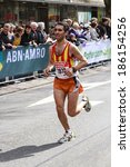 Small photo of Rotterdam, The Netherlands - April 11, 2010: Runner, Ferran Rey Roncero, crossing the line in the 30th edition of the ABN AMRO Rotterdam Marathon. The Netherlands biggest one-day sports event.