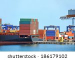 container stack and ship under... | Shutterstock . vector #186179102