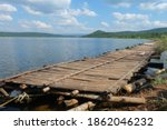 A Wooden Bridge On The Water...