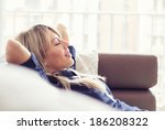 relaxed young woman lying on... | Shutterstock . vector #186208322