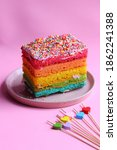 Rainbow Cake On A Pink Plate...