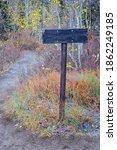 Trail Sign On Red Pine And...