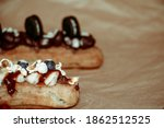 Eclairs Decorated With...