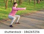 strong sporty woman doing squat ... | Shutterstock . vector #186265256