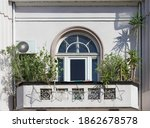An Arch On Window On Balcony ...