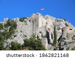 Small photo of Omis. Old Town in Croatia. Mirabela fortress on the rocks.