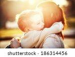 mother hugging her child during ... | Shutterstock . vector #186314456