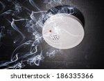 smoke detector in the smoke of... | Shutterstock . vector #186335366