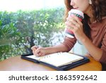 business woman write down on...   Shutterstock . vector #1863592642