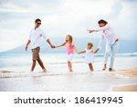 happy young family walking on... | Shutterstock . vector #186419945