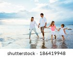 happy young family walking on... | Shutterstock . vector #186419948