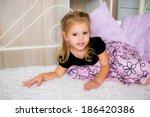 cute little girl in dress on... | Shutterstock . vector #186420386