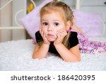 cute little girl in dress on... | Shutterstock . vector #186420395