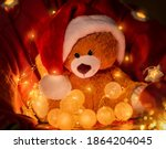 Soft Toy In A Santa Hat On A...