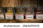 Photo Of Spice Jars In A Wooden ...