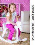 little girl and horse   rocking ... | Shutterstock . vector #186510008