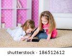 cute kids using modern tablet...   Shutterstock . vector #186512612