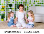 woman and little girls making a ... | Shutterstock . vector #186516326