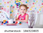 little child drawing using... | Shutterstock . vector #186523805