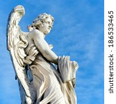 Angel with the garment and dice, Ponte Sant'Angelo, Rome - stock photo