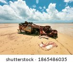 Old Rusted Wrecked Car On Beach