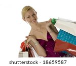 Glowing young blonde laden with shopping bags - stock photo