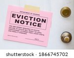 Pink Eviction Notice Taped On...