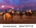 Small photo of Fallon, Nevada - August 3, 2014: Cowboys on horseback in a rodeo at the Churchill County Fairgrounds in the city of Fallon, in the State of Nevada.