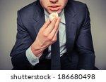 A Businessman Sitting In An...