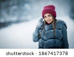 Cute Girl In A Gray Fur Coat...